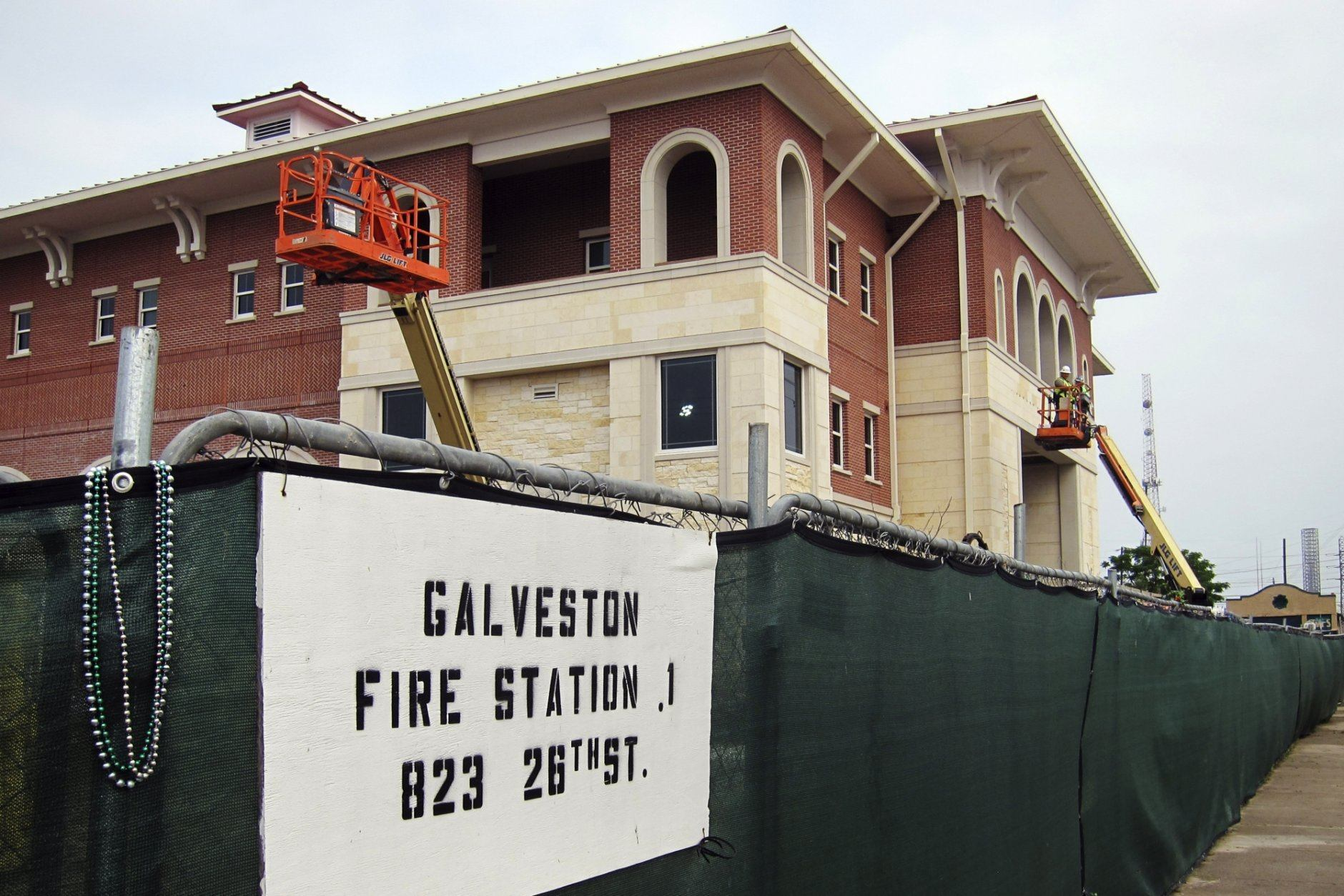 In this Thursday, May 9, 2019, crews in Galveston, Texas, work to finish construction of a downtown fire station that is being built with federal funding the Texas Gulf Coast city received to rebuild infrastructure that was damaged during Hurricane Ike in 2008. The new fire station is one of more than 500 projects that were built or have nearly been completed as the city has worked to come back from Ike's devastating flooding. (AP Photo/Juan A. Lozano)