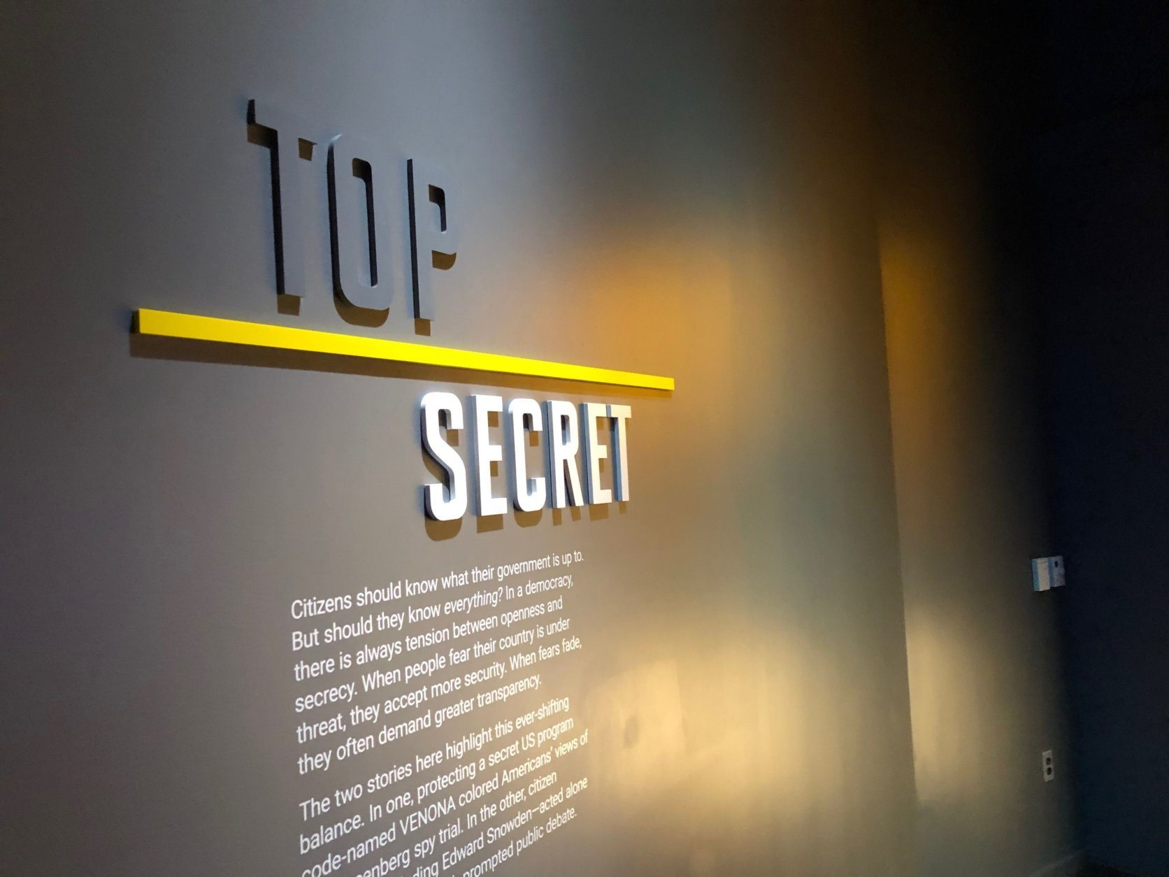 A plaque inside the new Spy Museum. (WTOP/J.J. Green)