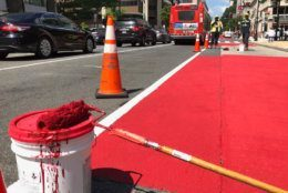 Bright red paint will mark a dedicated bus lane on H Street between 18th and 14th streets in Northwest and on I Street between 13th and 20th streets Northwest. (WTOP/Kristi King)