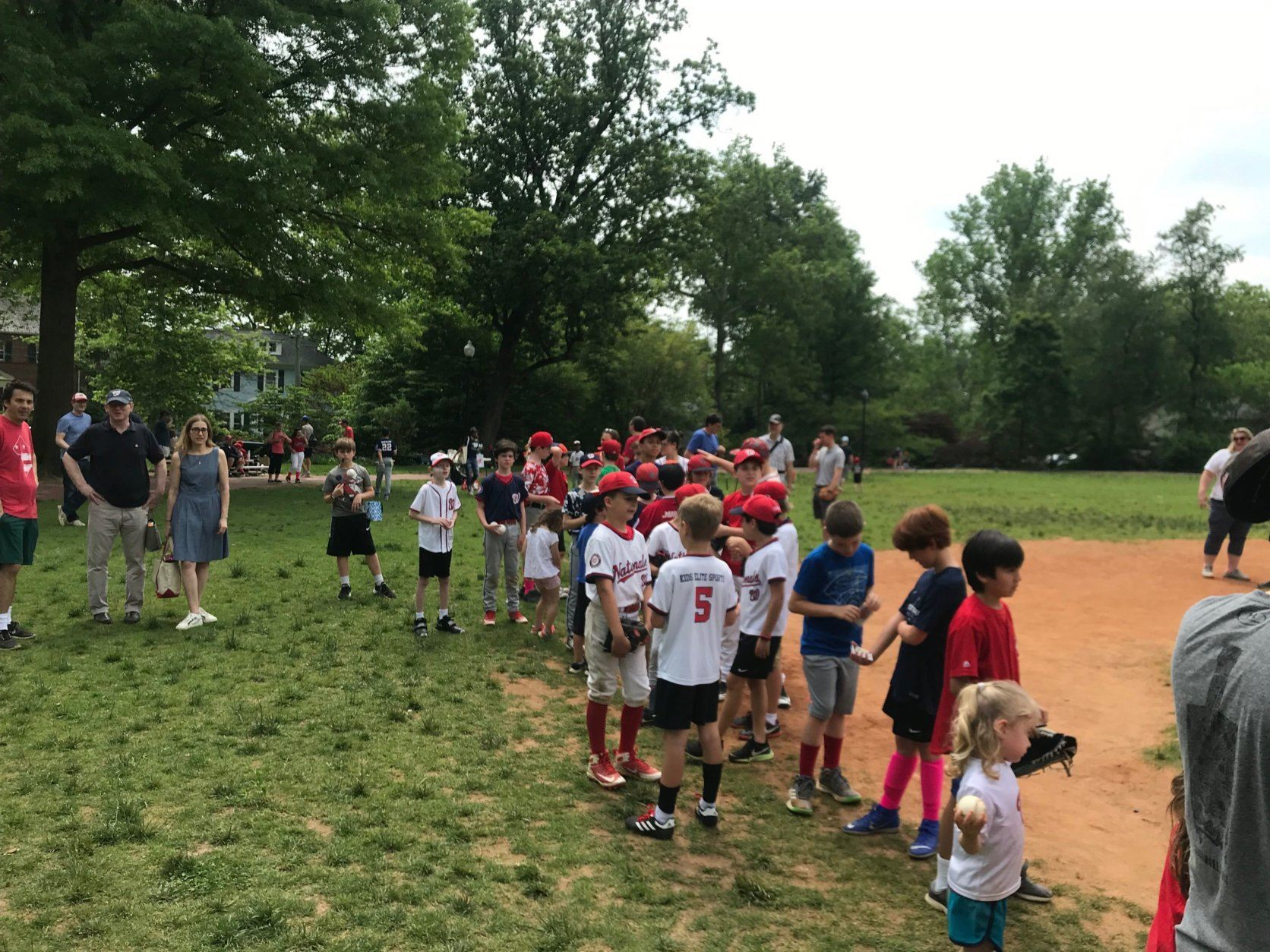 Players with the Capitol City Little League line up to meet Nationals star left-handed pitcher Patrick Corbin at Lafayette Recreation Center in NW D.C. (WTOP/Dick Uliano)