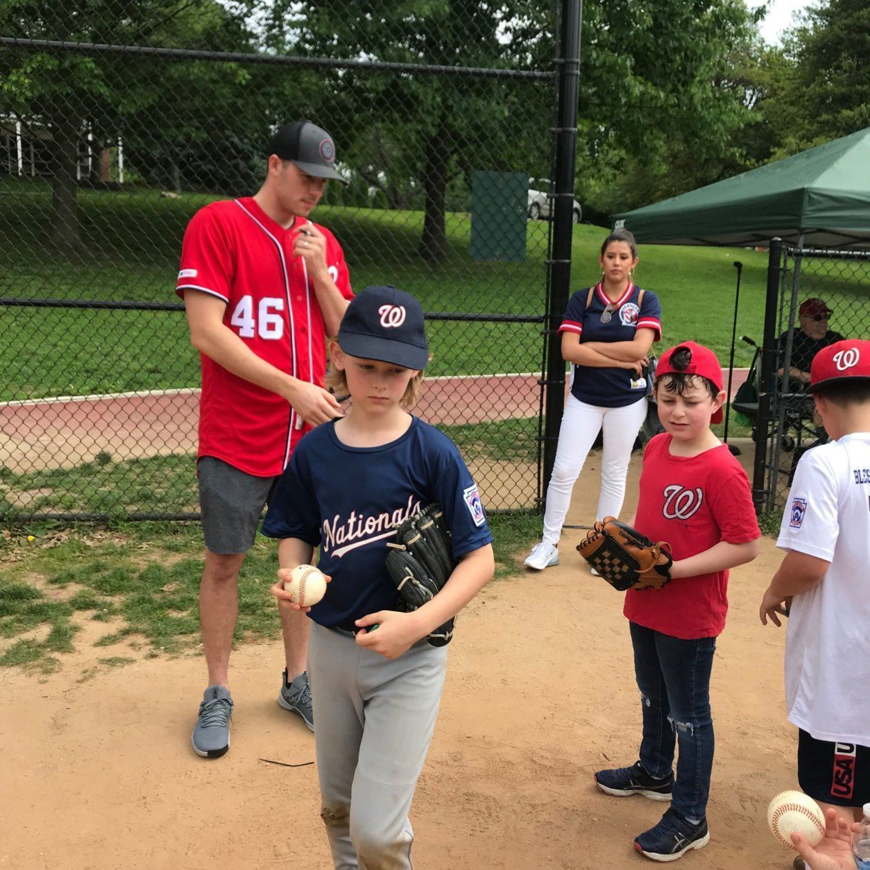 Nationals star left-handed pitcher Patrick Corbin hands out autographs and baseballs. (WTOP/Dick Uliano)