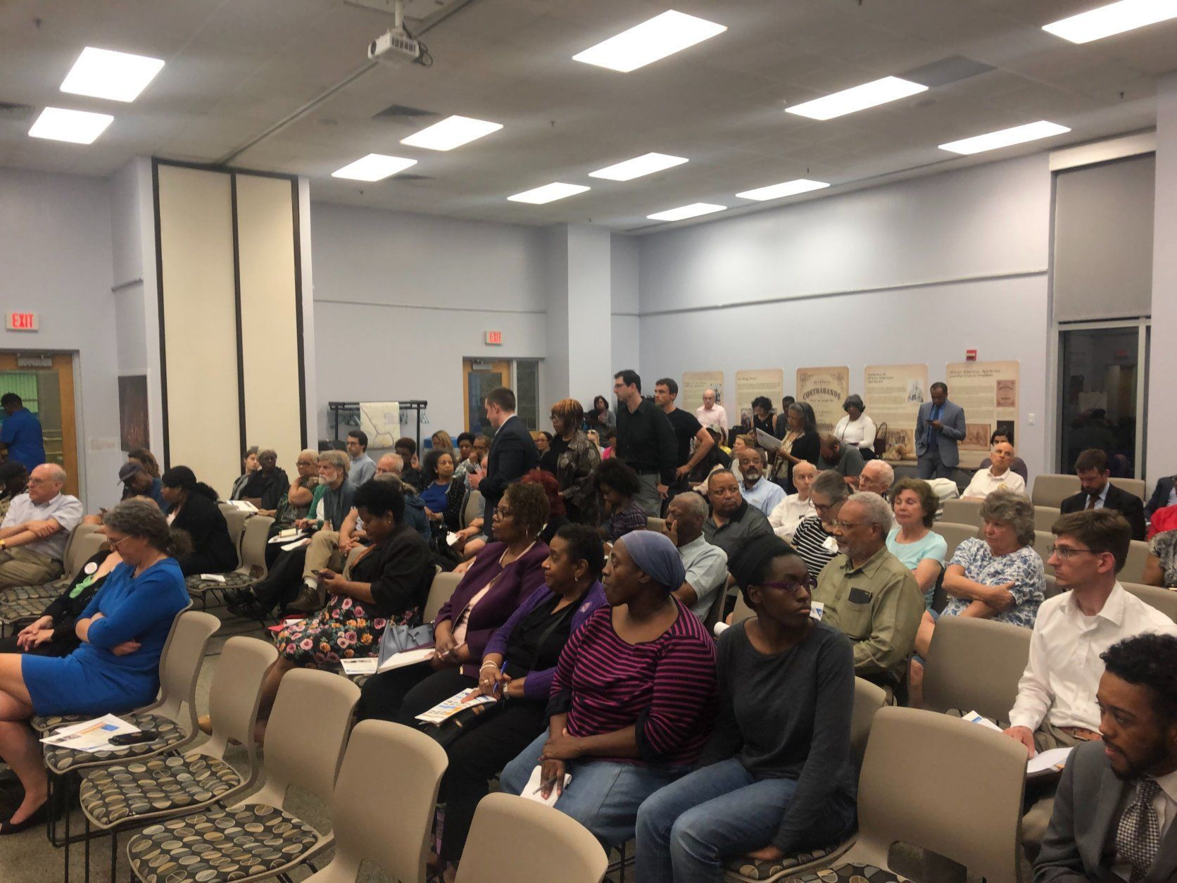 Among the concerns expressed by those in attendance are the 1,500 properties along both highways that would be affected, and the 34 homes claimed to make room for construction. (WTOP/Mike Murillo)