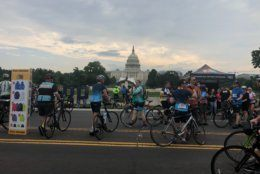 Bikers ride by the Capitol Building in a car-free D.C. as they take part in the D.C. Bike Ride. (WTOP/Melissa Howell)