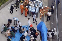 This aerial photo shows the scene of an attack in Kawasaki, near Tokyo Tuesday, May 28, 2019. A man wielding a knife attacked commuters waiting at a bus stop just outside Tokyo during Tuesday morning's rush hour, Japanese authorities and media said. (Jun Hirata/Kyodo News via AP)