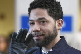 "FILE - In this March 26, 2019, file photo, actor Jussie Smollett waves as he leaves Cook County Court after his charges were dropped in Chicago. A judge in Chicago has ordered the file in the Smollett criminal case unsealed. Cook County Judge Steven Watkins said Thursday, May 23, 2019, that while there are good arguments in favor of keeping the file sealed, the ""Empire"" actor forfeited his rights to keep the case sealed to protect his privacy by talking to the media before and after prosecutors dismissed the charges against him. (AP Photo/Paul Beaty)"