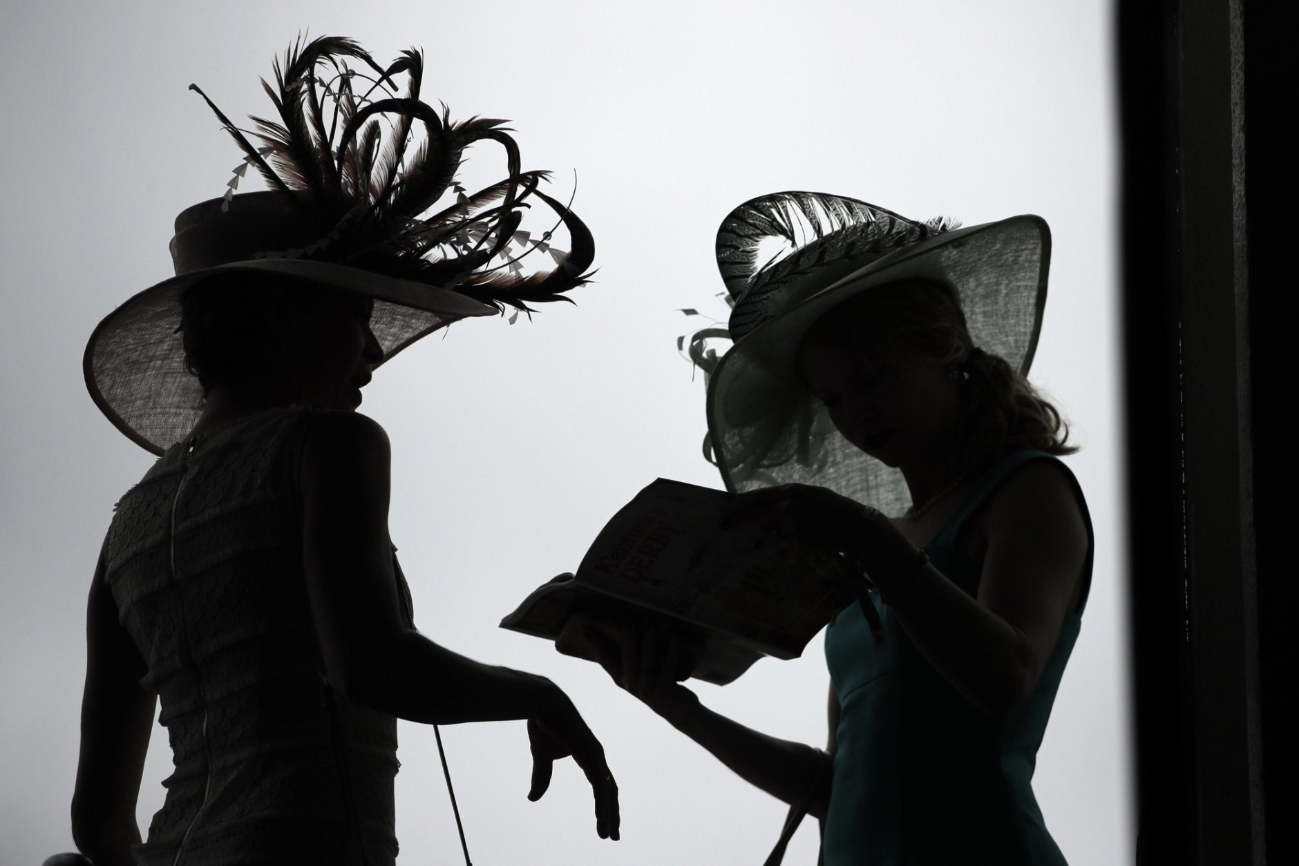 Women wear a hat before the 145th running of the Kentucky Derby horse race at Churchill Downs Saturday, May 4, 2019, in Louisville, Ky. (AP Photo/Charlie Riedel)