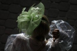 A woman wears a hat before the 145th running of the Kentucky Derby horse race at Churchill Downs Saturday, May 4, 2019, in Louisville, Ky. (AP Photo/Charlie Riedel)