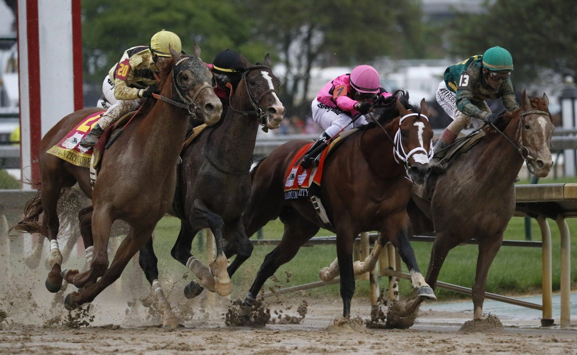 Flavien Prat on Country House, left, races against Luis Saez on Maximum Security, second from right, during the 145th running of the Kentucky Derby horse race at Churchill Downs Saturday, May 4, 2019, in Louisville, Ky. Maximum Security was disqualified and Country House won the race. (AP Photo/John Minchillo)