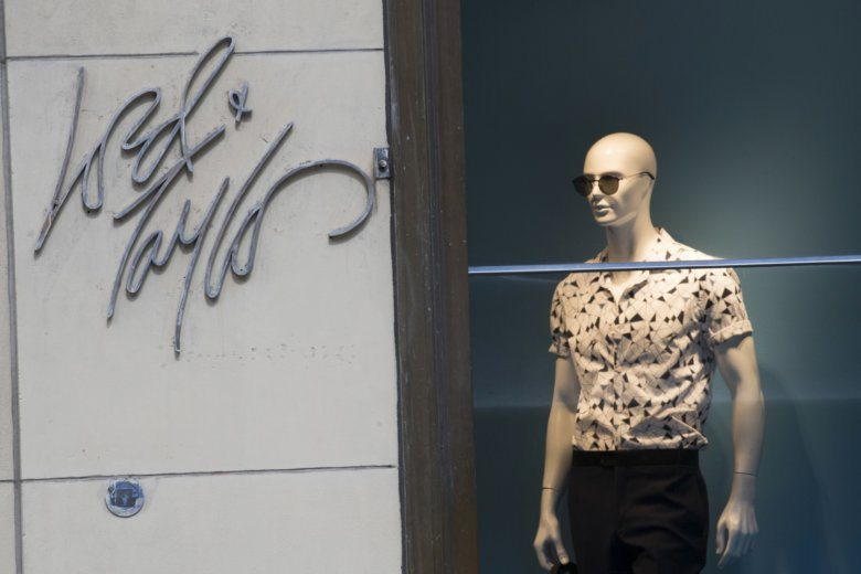 f0fc708c304e4 FILE - In this June 6, 2018, file photo the Lord & Taylor logo is seen next  to a mannequin in a window display at their flagship store on Fifth Avenue  in.