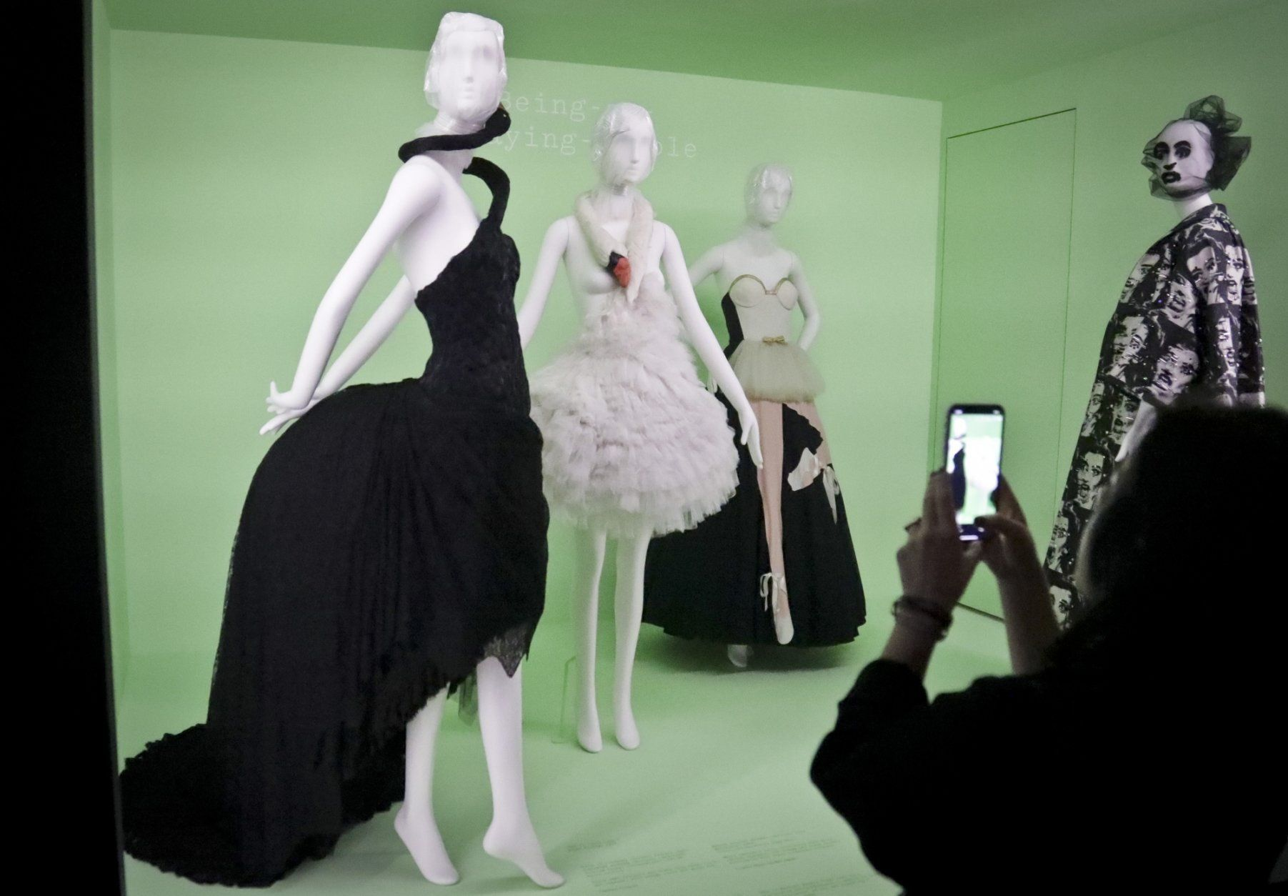 """Fashion from Gucci, from left, Givenchy, Moshino and Marc Jacobs appear at a press preview in the Metropolitan Museum of Art's Costume Institute exhibit, titled, """"Camp: Notes on Fashion,"""" Monday, May 6, 2019, in New York. (AP Photo/Bebeto Matthews)"""