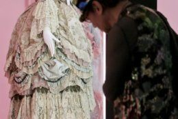 """17th century fashion is displayed in the Metropolitan Museum of Art's Costume Institute gala exhibit, """"Camp: Notes on Fashion,"""" is unveiled for a press preview, Monday, May 6, 2019, in New York. (AP Photo/Bebeto Matthews)"""