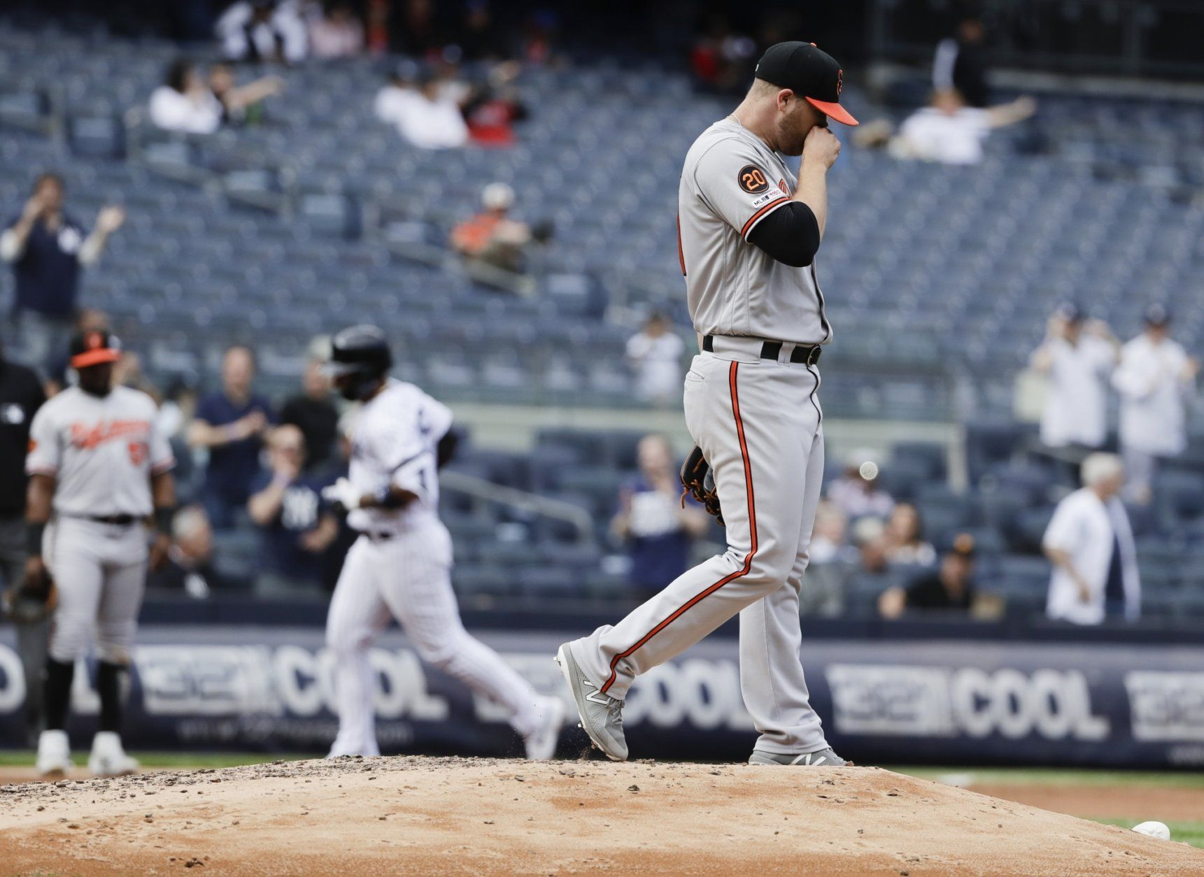 Baltimore Orioles' David Hess, right, reacts as New York Yankees' Gleyber Torres, left, runs the bases after hitting a home run during the fourth inning of a baseball game Wednesday, May 15, 2019, in New York. (AP Photo/Frank Franklin II)