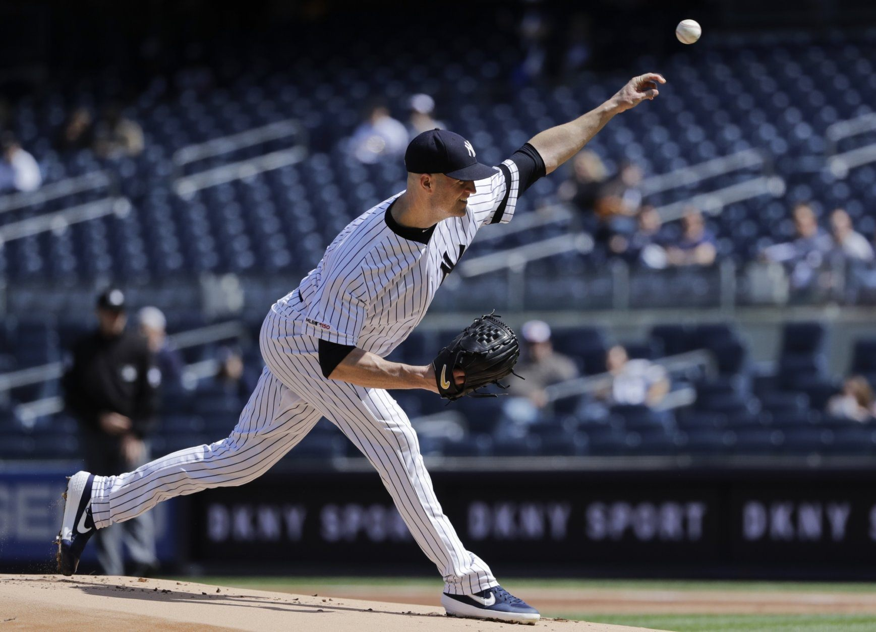 New York Yankees' J.A. Happ delivers a pitch during the first inning of a baseball game against the Baltimore Orioles Wednesday, May 15, 2019, in New York. (AP Photo/Frank Franklin II)