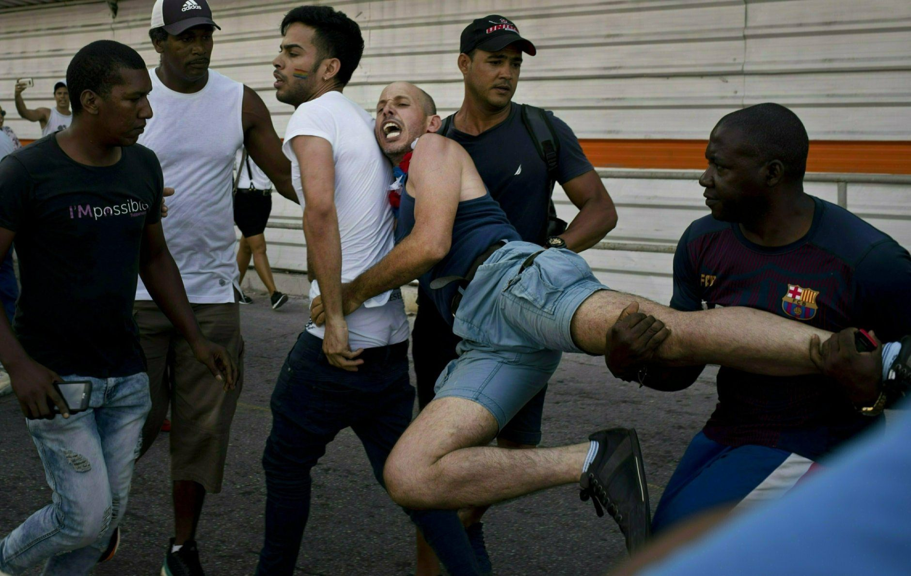 Police detain a gay rights activist taking part in an unauthorized march in Havana, Cuba, Saturday, May 11, 2019. The march was organized using Cuba's new mobile internet, with activists and supporters calling for a rally over Facebook and WhatsApp after the government-run gay rights organization cancelled a Saturday march. (AP Photo/Ramon Espinosa)