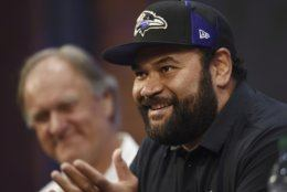 Former Baltimore Ravens NFL football player  Haloti Ngata, right, speaks about his retirement during a news conference with former head coach Brian Billick, left, Wednesday, May 29, 2019, in Owings Mills, Md. (AP Photo/Gail Burton)