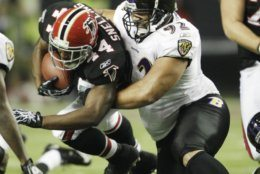 FILE - In this Nov. 11, 2010, file photo, Atlanta Falcons running back Jason Snelling (44) is stopped by Baltimore Ravens defensive tackle Haloti Ngata (92) In the first quarter of an NFL football game in Atlanta. Ngata came into the NFL with Baltimore and will leave as a member of the Ravens, the team that provided him with his best memories and a Super Bowl ring. (AP Photo/David Goldman, File)