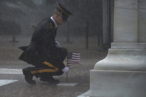 Soldier braves storms at Arlington Cemetery to honor fallen comrades