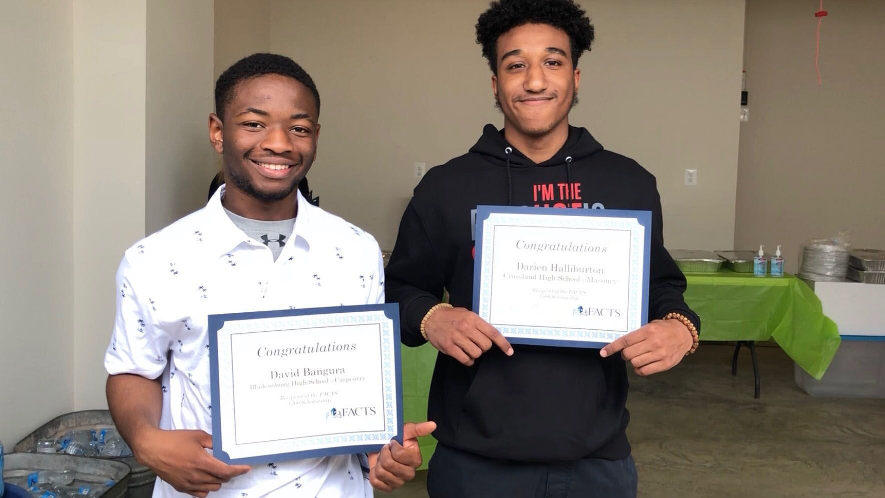 David Bangura and Darian Halliburton, winners of $500 scholarships. (WTOP/Kristi King)