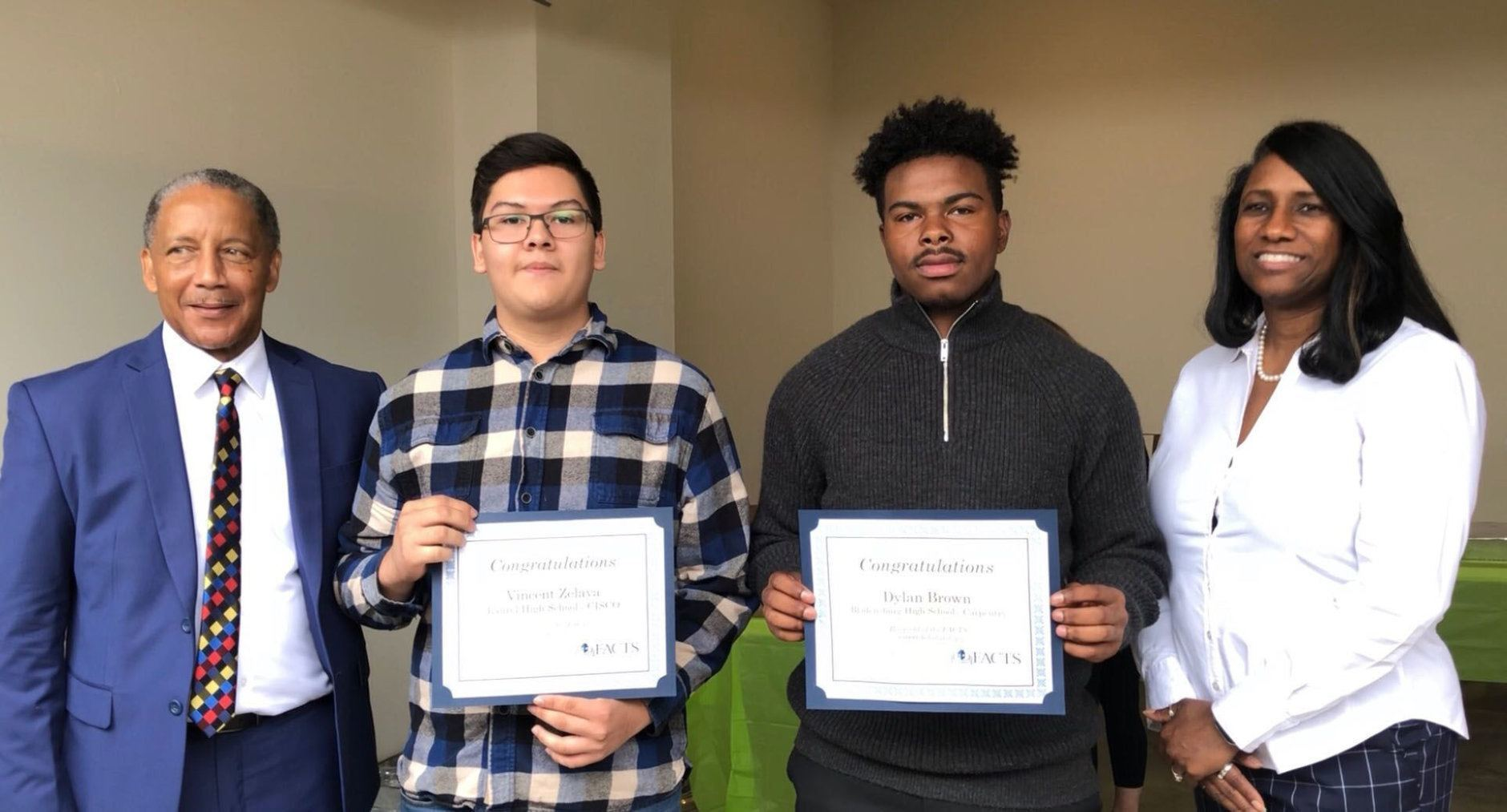 Vincent Zelaya and Dylan Brown, $1,000 Scholarship winners, are pictured with FACTS Chair Howard Burnett and Prince George's County School Board member Sonya Williams. (WTOP/Kristi King)