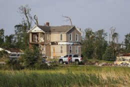 Homes stand damaged after a tornado passed through the area the previous evening, Tuesday, May 28, 2019, in Brookville, Ohio. (AP Photo/John Minchillo)