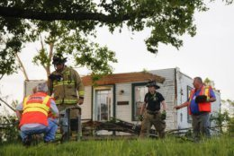 Storm damage litters a residential neighborhood, Tuesday, May 28, 2019, in Vandalia, Ohio. A rapid-fire line of apparent tornadoes tore across Indiana and Ohio overnight, packed so closely together that one crossed the path carved by another. At least half a dozen communities from eastern Indiana through central Ohio suffered damage, according to the National Weather Service, though authorities working through the night had reported no fatalities as of early Tuesday. (AP Photo/John Minchillo)