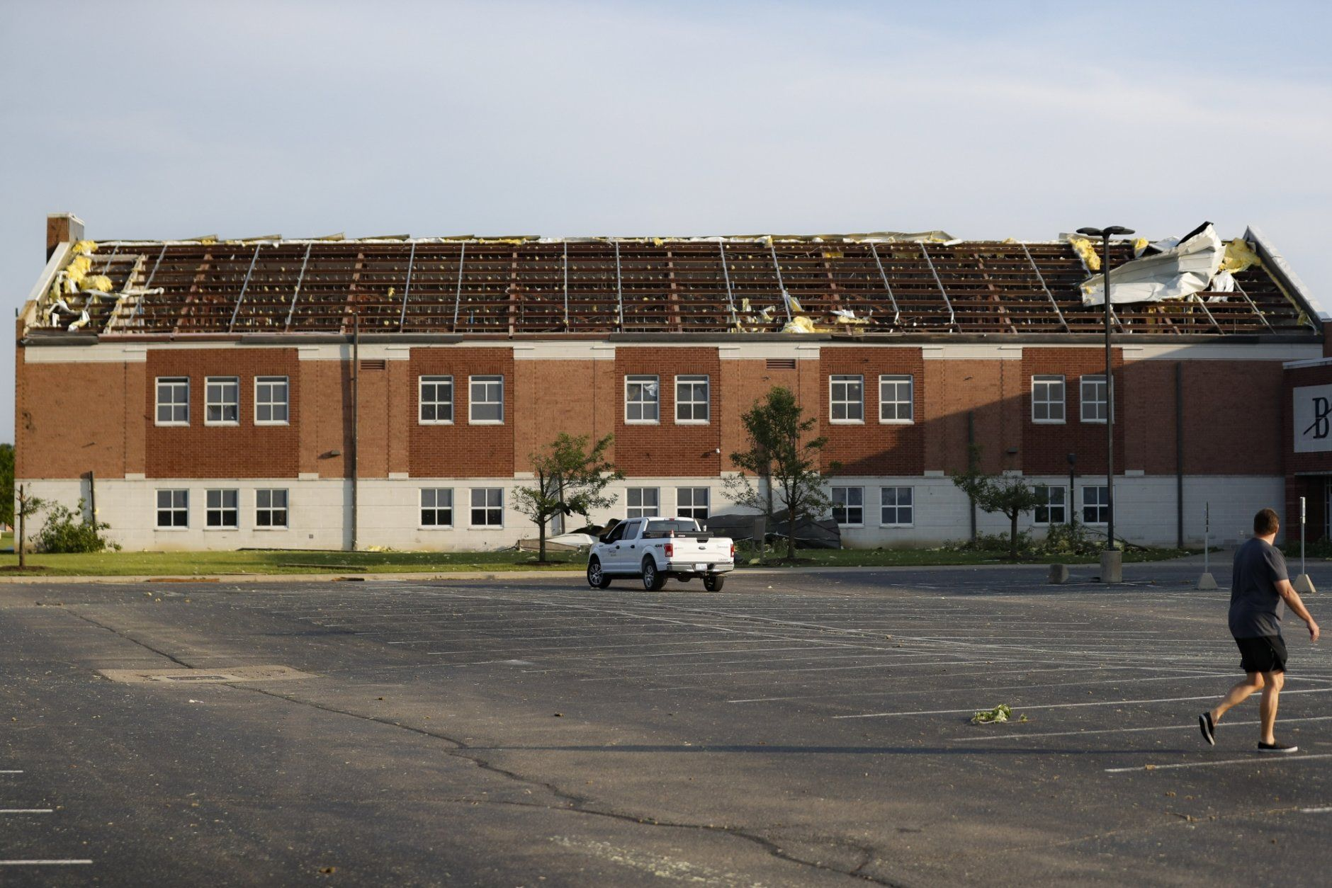 A section of roof remains torn from Brookville High School after a tornado hit the area the previous evening, Tuesday, May 28, 2019, in Brookville, Ohio.  (AP Photo/John Minchillo)
