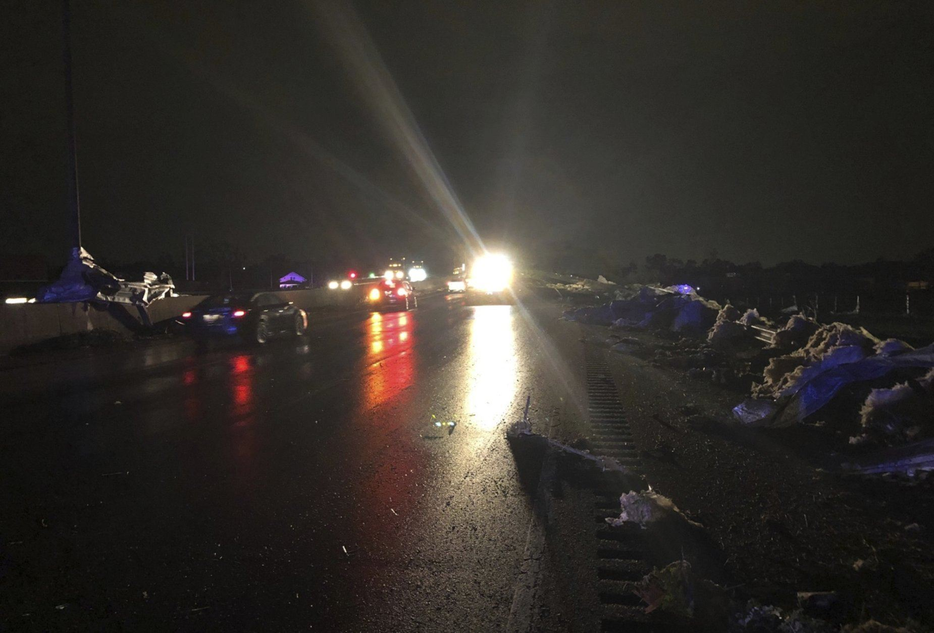 This image provided and posted by the Ohio Department of Transportation, early Tuesday, May 28, 2019, shows crews on Interstate 75 north of Dayton, Ohio, working to clean debris from the highway after a suspected tornado hit the area. (Ohio Department of Transportation via AP)