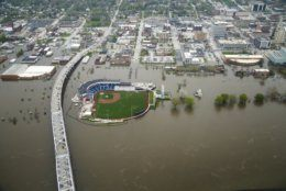 Downtown Davenport, Iowa,  is seen from the air as flood waters continue flow on Wednesday, May 1, 2019.  A flood wall broke on Tuesday sending water to near record levels with little to no warning.  (Brian Powers/The Des Moines Register via AP)