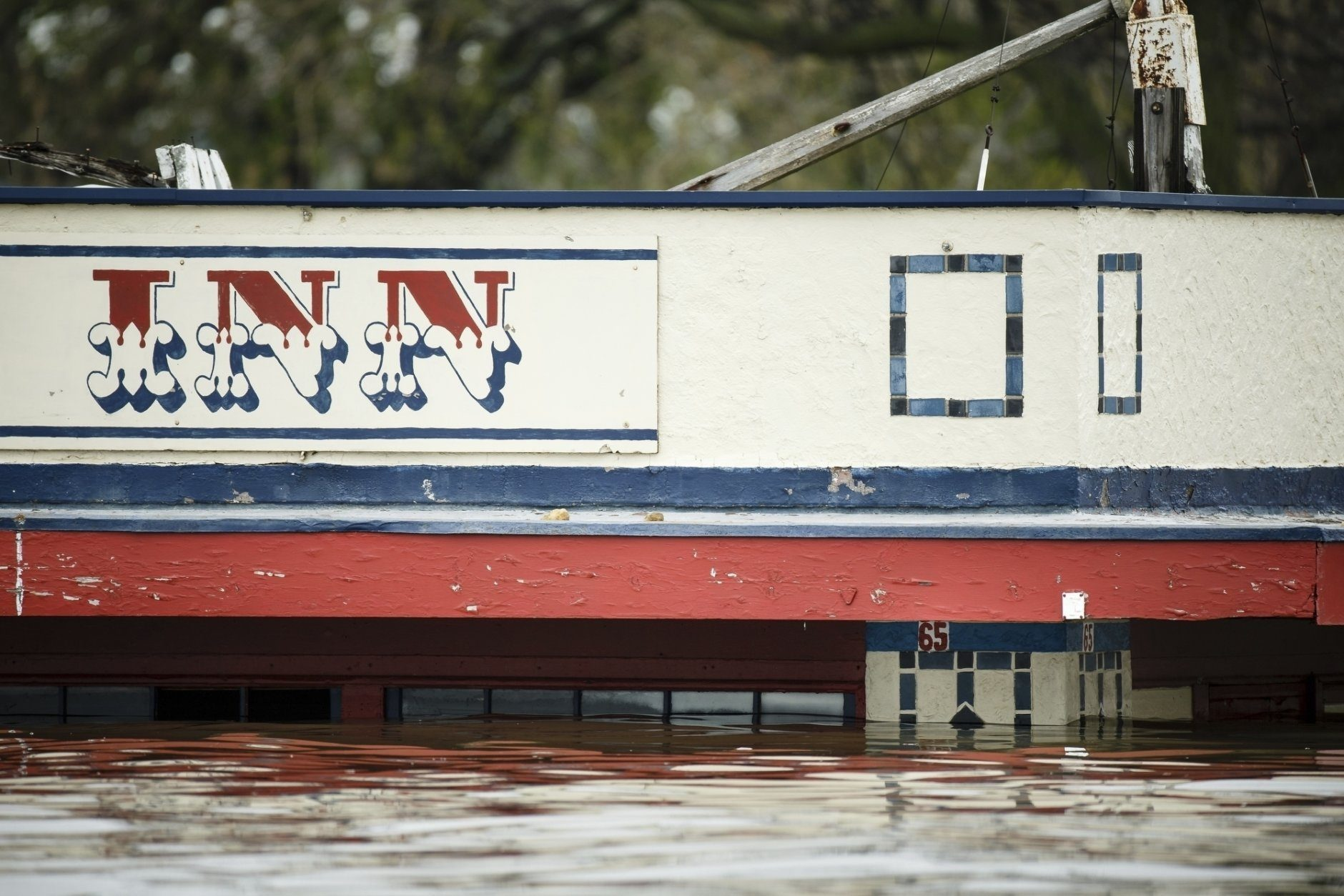 Flood water get close to the high water mark from the 1965 flood under the awning of The Levee Inn in Downtown Davenport on Wednesday, May 1, 2019, in Davenport, Iowa. A flood wall broke on Tuesday sending water to near record levels with little to no warning.  (Brian Powers/The Des Moines Register via AP)