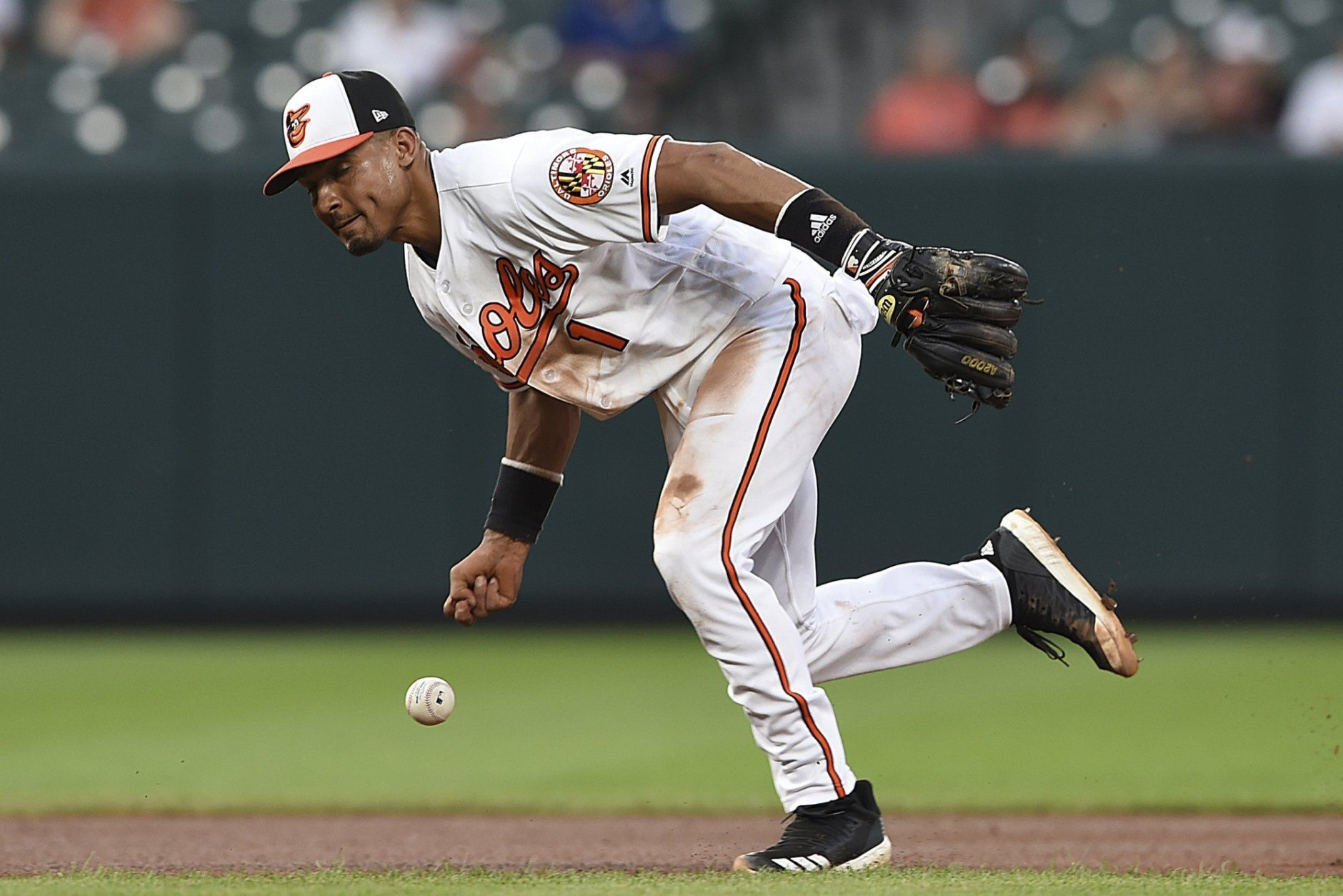 Baltimore Orioles shortstop Richie Martin is unable to hold on to a slow grounder hit by Detroit Tigers' Niko Goodrum during the fourth inning of a baseball game Wednesday, May 29, 2019, in Baltimore. Goodrum earned a single on the play. (AP Photo/Gail Burton)