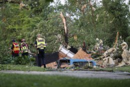 Storm damage liters a residential neighborhood, Tuesday, May 28, 2019, in Vandalia, Ohio. A rapid-fire line of apparent tornadoes tore across Indiana and Ohio overnight, packed so closely together that one crossed the path carved by another. (AP Photo/John Minchillo)