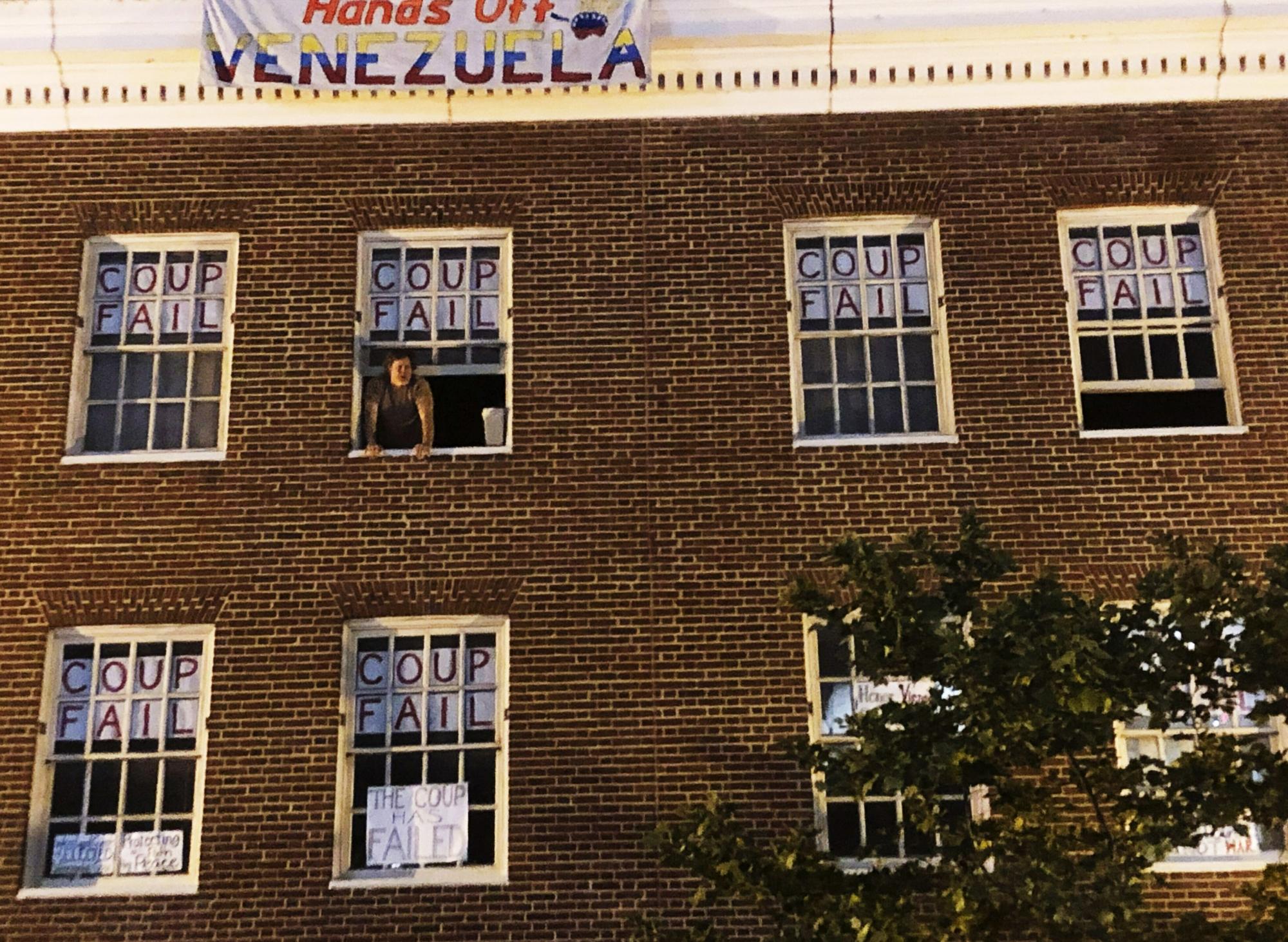 Activists at Venezuelan embassy in US ignore warning | WTOP