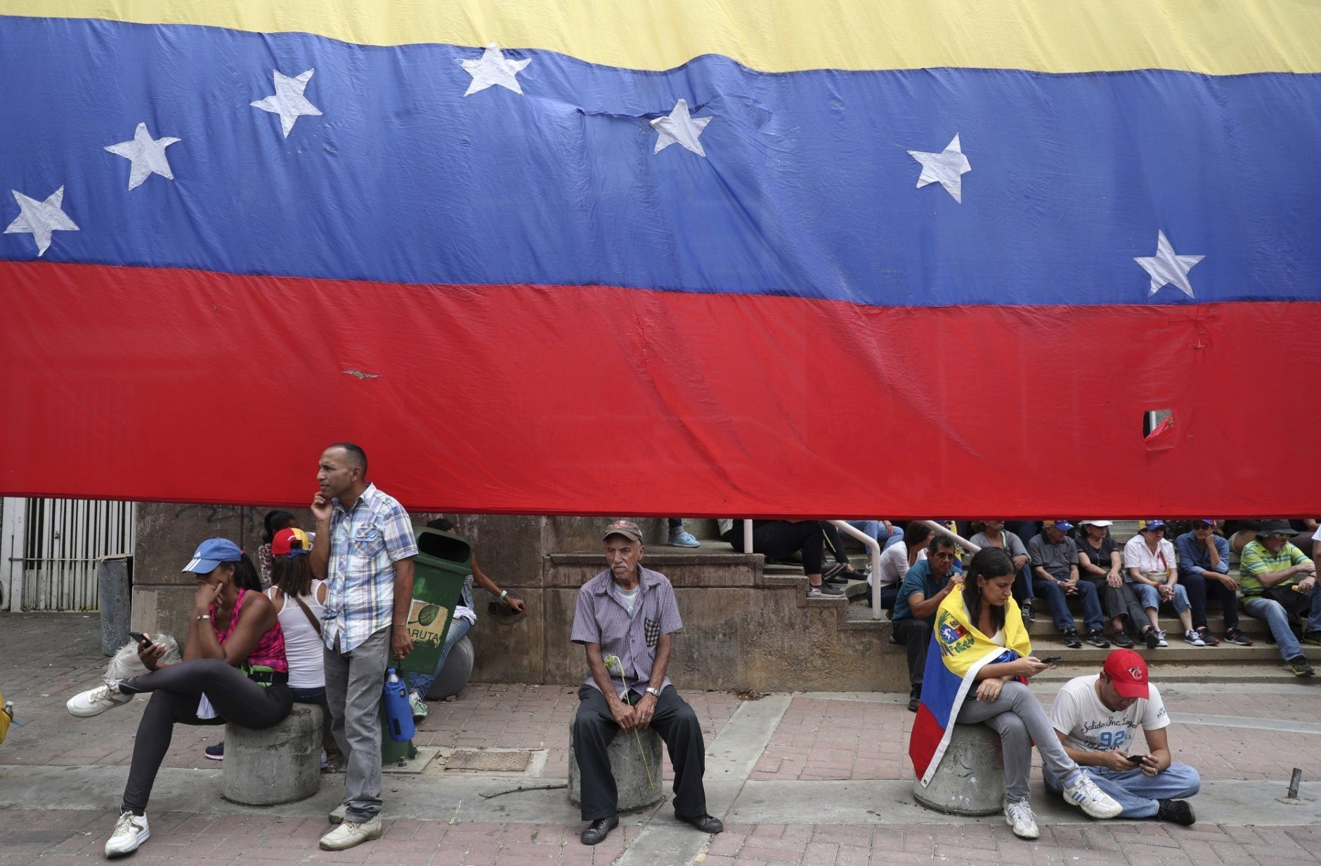 Opponents of the Nicolas Maduro government wait for the arrival of opposition leader Juan Guaidó to lead a rally in Caracas, Venezuela, Saturday, May 11, 2019. Guaidó has called for nationwide marches protesting the Maduro government, demanding new elections and the release of jailed opposition lawmakers. (AP Photo/Martin Mejia)
