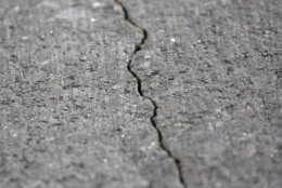 A crack is seen in the Atlantic granite arch at the World War II Memorial on the National Mall in Washington, Friday, May 24, 2019. (AP Photo/Carolyn Kaster)