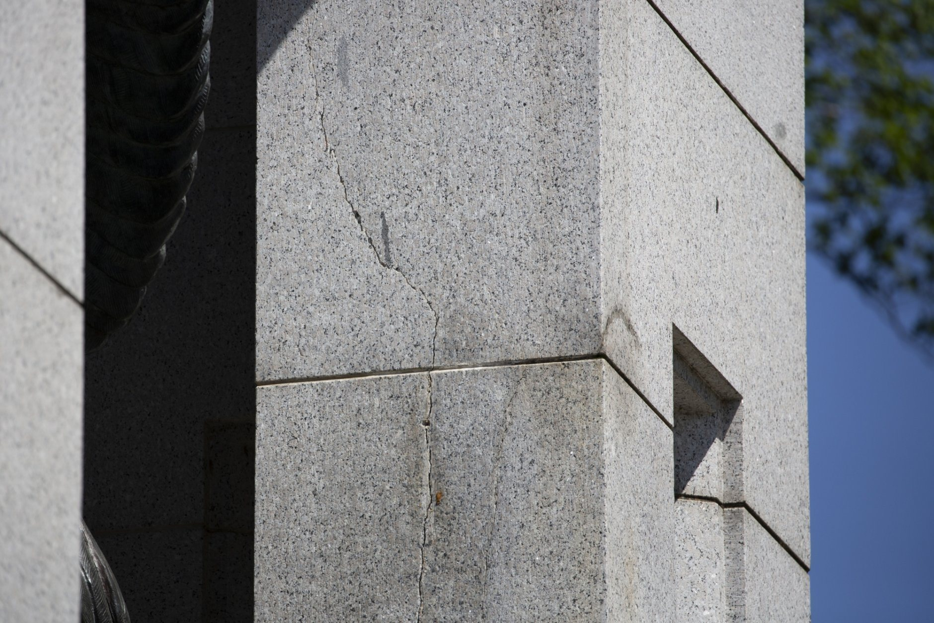 A crack is seen in Atlantic granite arch at the World War II Memorial on the National Mall in Washington, Friday, May 24, 2019. (AP Photo/Carolyn Kaster)