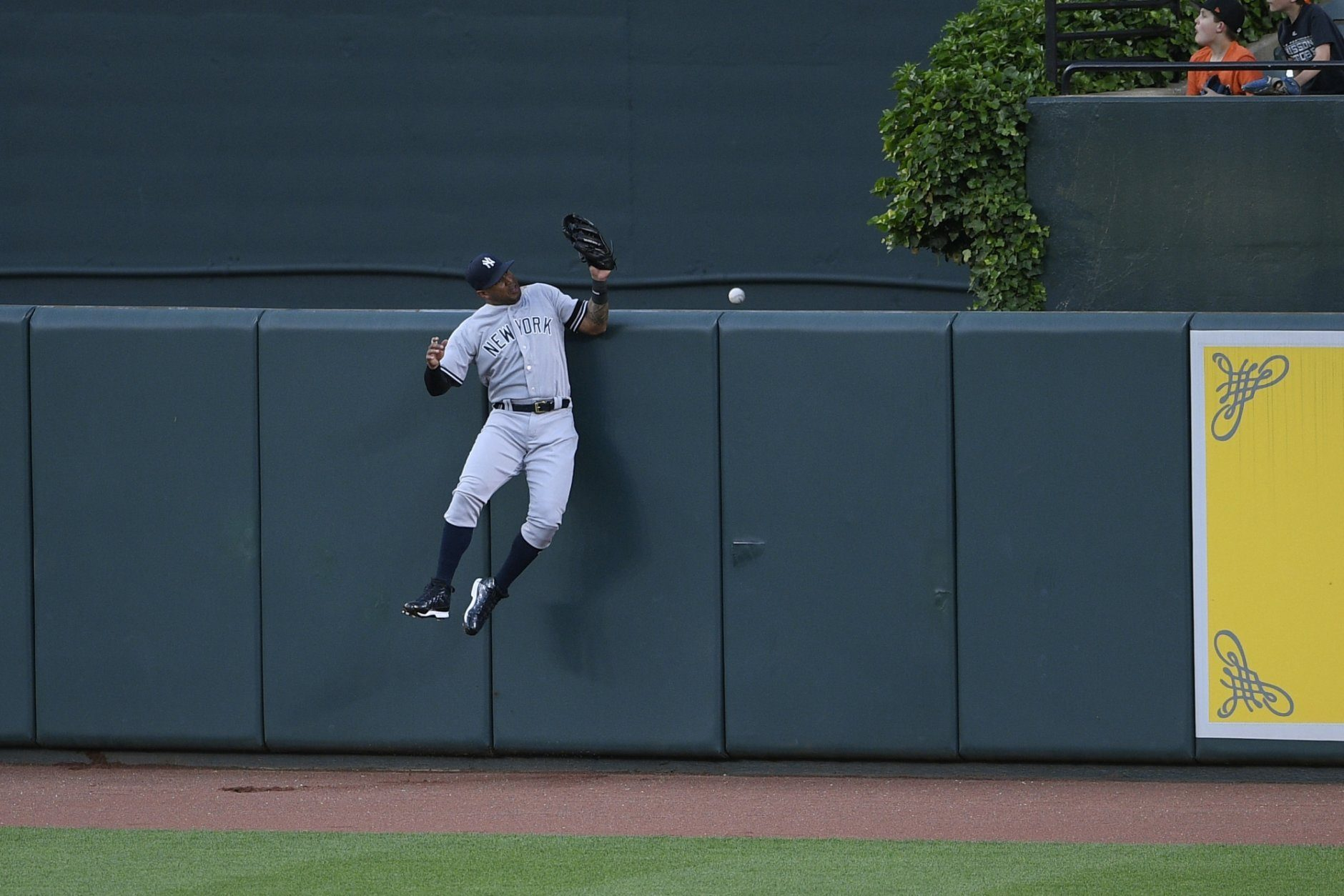 New York Yankees center fielder Aaron Hicks cannot get to a ball that went for a home run by Baltimore Orioles' Hanser Alberto during the third inning of a baseball game, Monday, May 20, 2019, in Baltimore. (AP Photo/Nick Wass)