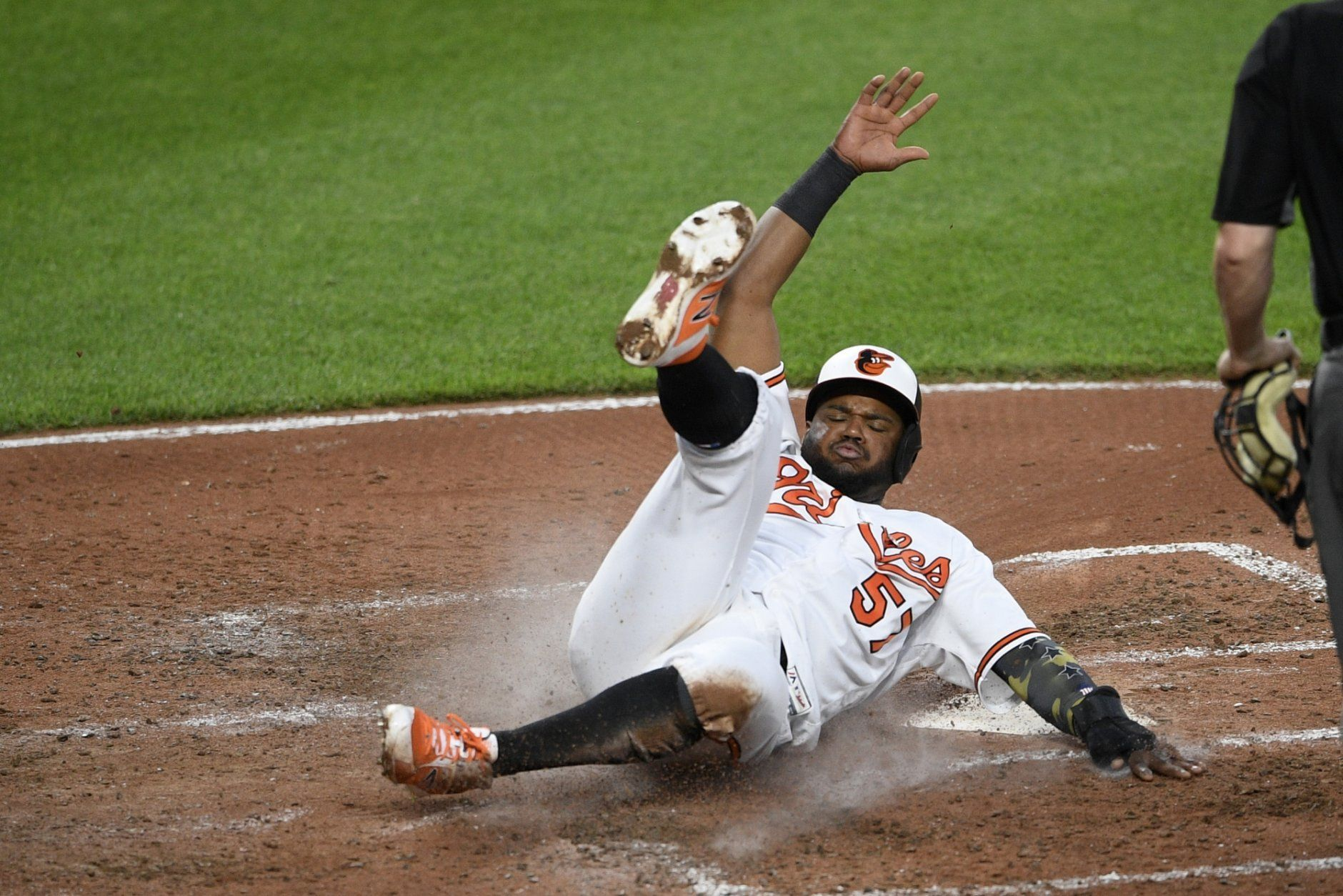 Baltimore Orioles' Hanser Alberto slides home to score a run on a single by Dwight Smith Jr. during the fourth inning of a baseball game against the New York Yankees, Monday, May 20, 2019, in Baltimore. (AP Photo/Nick Wass)