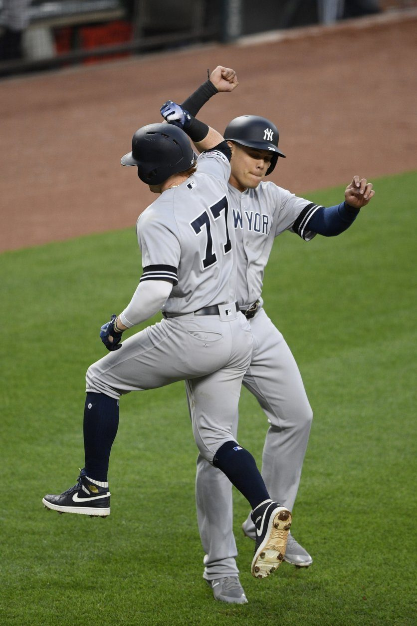 New York Yankees' Clint Frazier (77) celebrates his two-run home run with Gio Urshela during the third inning of the team's baseball game against the Baltimore Orioles, Tuesday, May 21, 2019, in Baltimore. (AP Photo/Nick Wass)