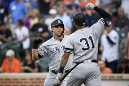 New York Yankees' Gary Sanchez, left, celebrates his three-run home run with Aaron Hicks (31) during the first inning of the team's baseball game against the Baltimore Orioles, Tuesday, May 21, 2019, in Baltimore. (AP Photo/Nick Wass)