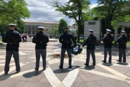 Law enforcement officers stand guard during a vigil Tuesday, May 14, 2019, to honor fallen officers. (WTOP/Kristi King)