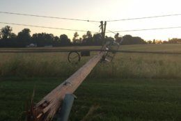 A pole was toppled over in Howard County near Triadelphia and Howard Road Friday morning after thunderstorms and a confirmed tornado hit the region. (WTOP/John Domen)