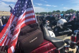 The American flag flies from the back of a motorcycle. (WTOP/Melissa Howell)