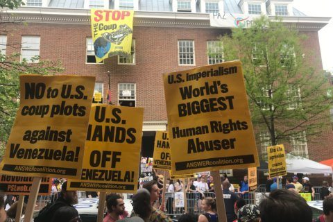 Protests continue outside Venezuelan embassy building in DC