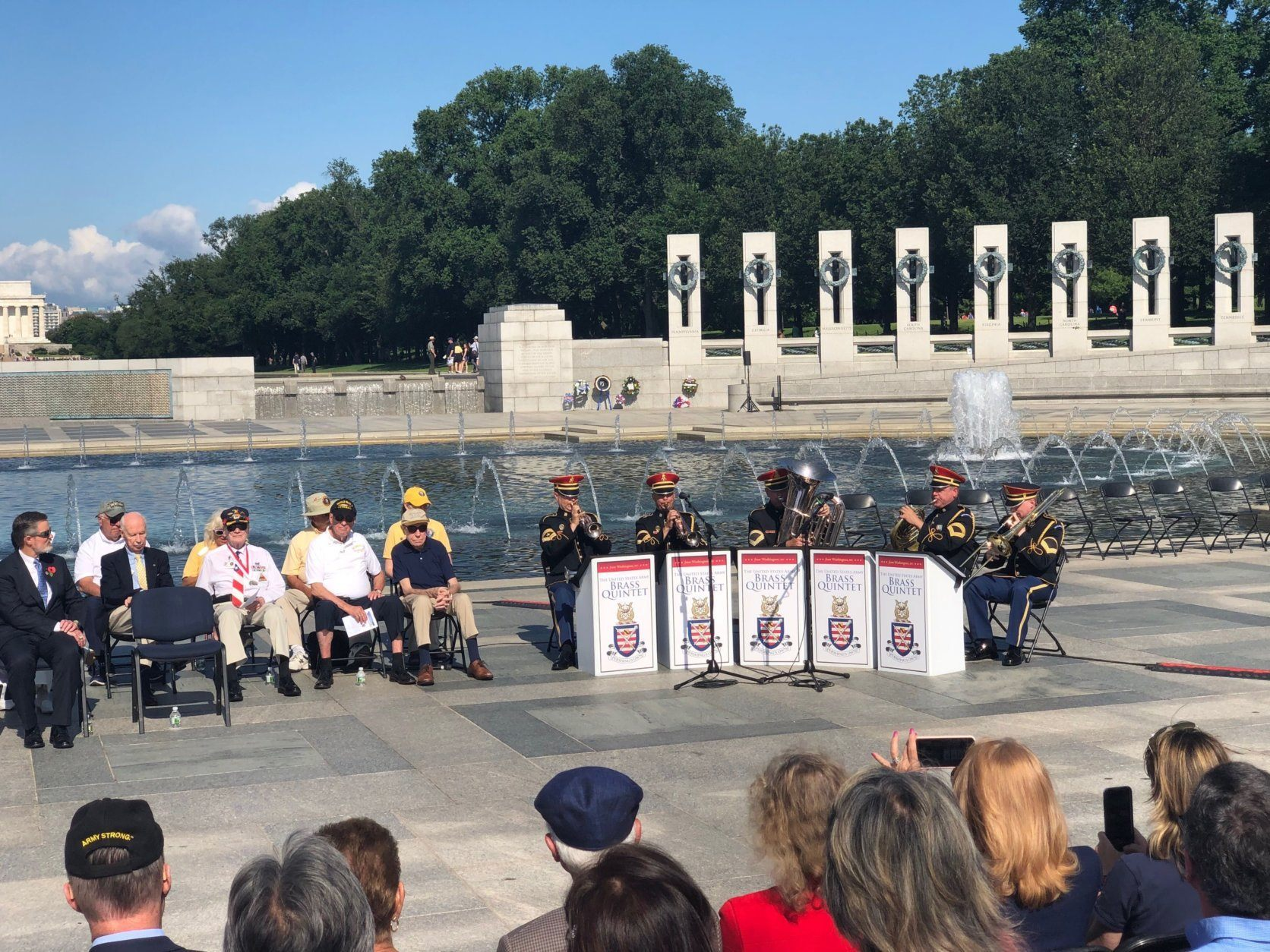 A brass quintet from the U.S. Army band Pershing's Own plays at the memorial on Monday, May 27, 2019. (WTOP/Keara Dowd)