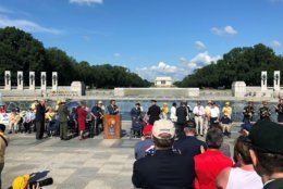 Roaring applause takes place at the World War II Memorial on Monday, May 27, 2019. (WTOP/Keara Dowd)