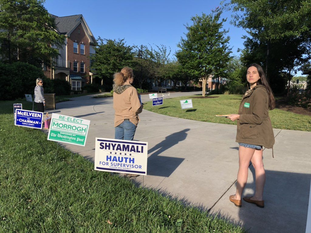 Candidate volunteers are up and at it early. Elena Lowe says she's out to support a really great candidate for Commonwealth's Attorney  at Reston, Virginia, precinct 223. (WTOP/Kristi King)