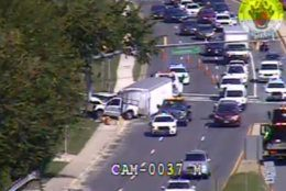 Police and emergency responders work to clear the crash on southbound Rockville Pike. (Courtesy MDOT)