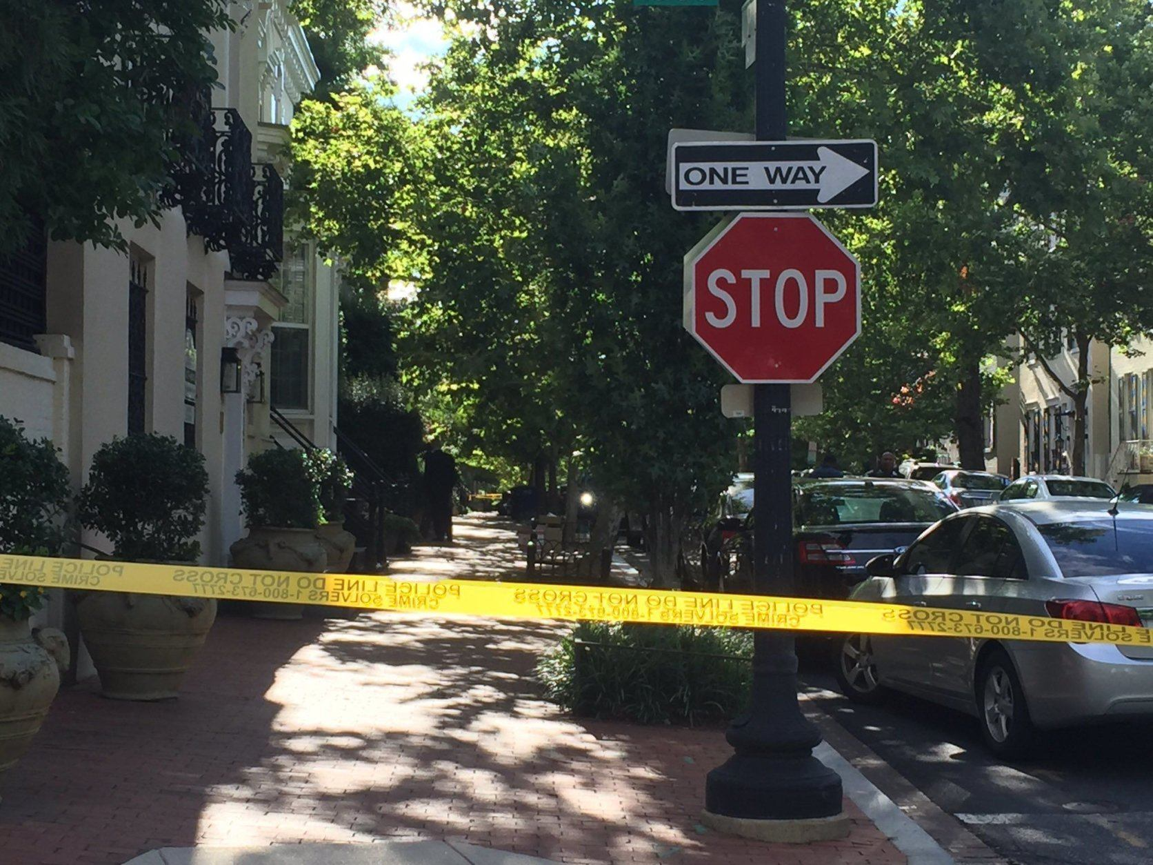 Yellow police tape is up around the Georgetown home of Jack Evans while the FBI conducts its search. (WTOP/John Domen)