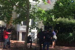 Media outside Jack Evans' home in Georgetown on Friday after an FBI search. (WTOP/John Domen)