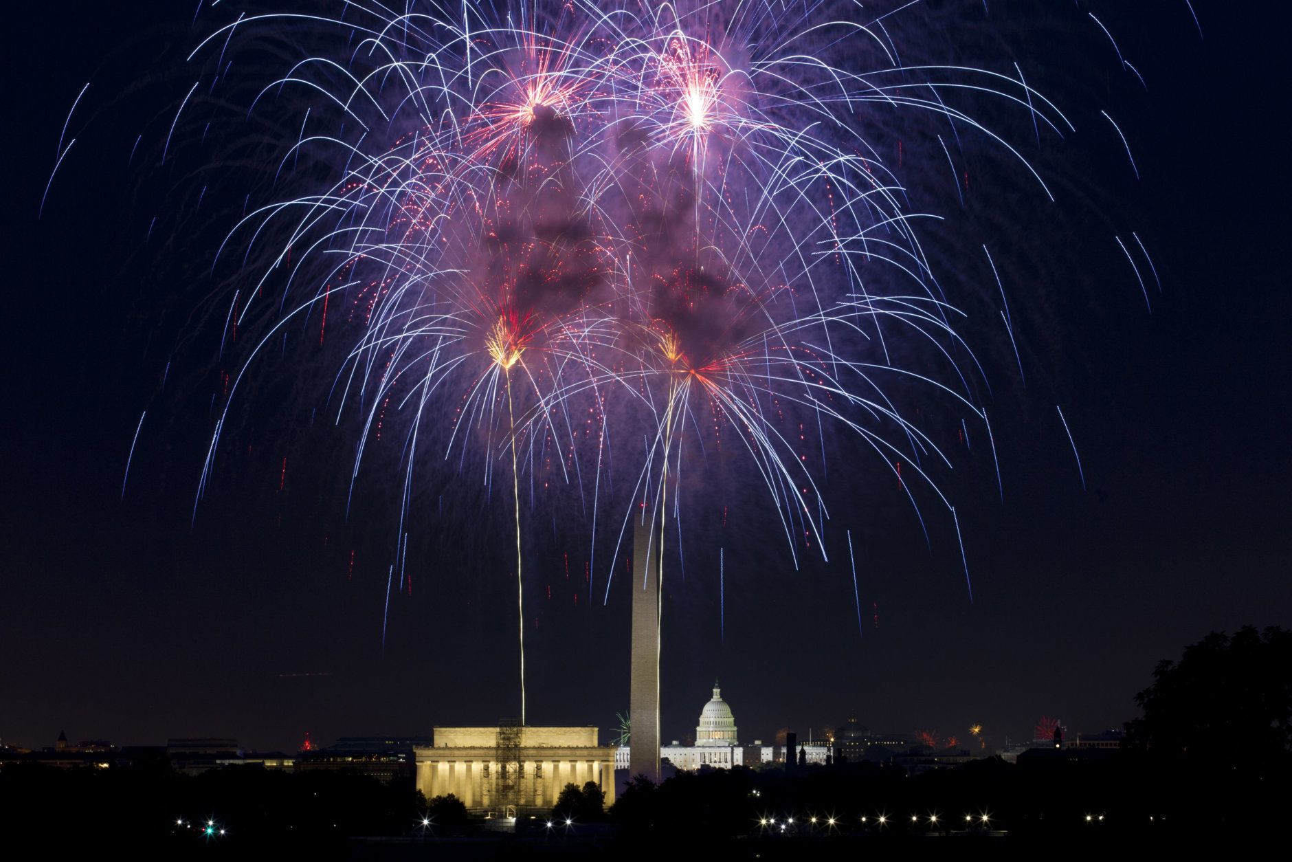 Fireworks explode over Lincoln Memorial, Washington Monument and U.S. Capitol along the National Mall in Washington, Wednesday, July 4, 2018, during the Fourth of July celebration. (AP Photo/Jose Luis Magana)